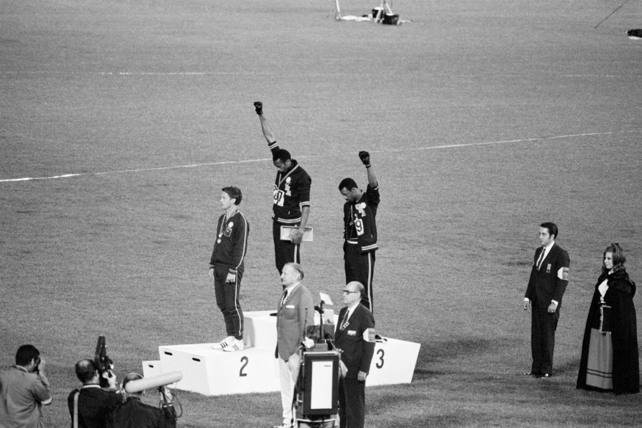 Mexico City, Mexico - Tommie Smith and John Carlos, gold and bronze medalists in the 200-meter run at the 1968 Olympic Games, engage in a victory stand protest against unfair treatment of blacks in the United States. (Oct 16, 1968)